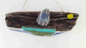 scultura barca a vela in sasso marino - arte marina